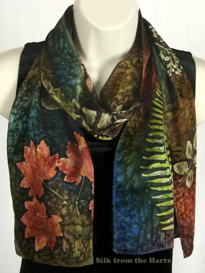 A unique botanical silk scarf artistically hand printed with leaves and branches and dyed in autumn colors for an elegant gift for gardeners and nature lovers.