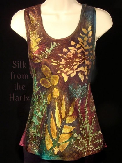 Handcrafted leaf print silk womens tank top in earth tones of green, brown, peach and denim